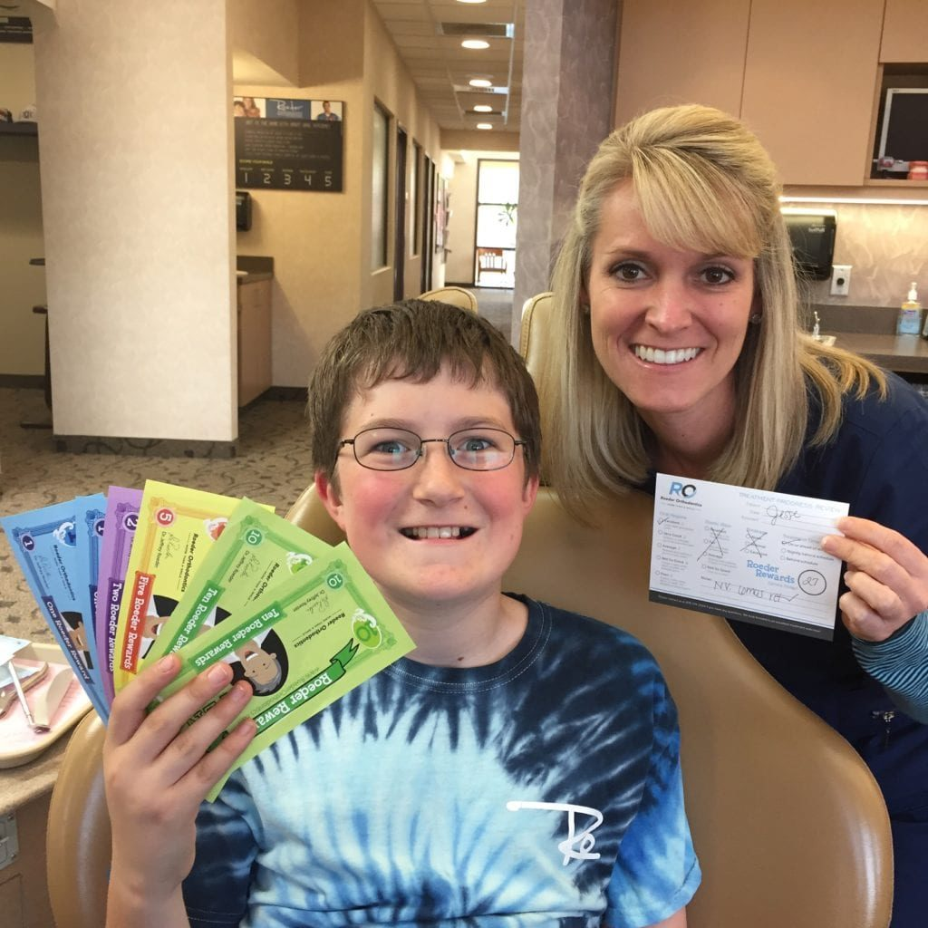 Patient and Roeder Orthodontics staff member with Roeder Bucks