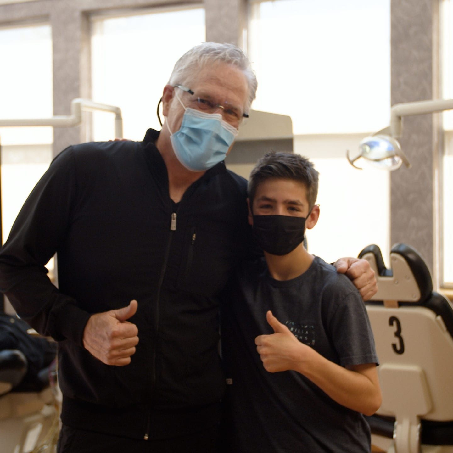 Dr. Roeder and patient giving thumbs up